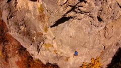 Rock climber aerial pan left to right Stock Footage