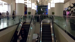 Busy escalators in metropolis shopping mall Stock Footage