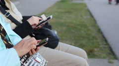 Reading mobile phone message at park Stock Footage