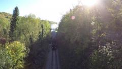 flying over steam engine locomotive. forest trees woods - stock footage