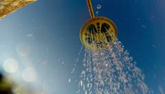 4k summer shower head on. a close-up of a shower head water spray under blue Stock Footage