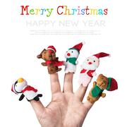christmas toys put on a hand on a white background - stock illustration