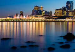vancouver skyline and canada place at night - stock photo