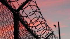 Razor + Barbed Wire | Blood Red Sunset Stock Footage