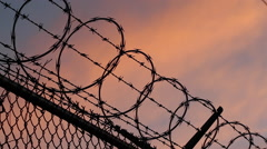 Razor + Barbed Wire | Blue Orange Sunset Stock Footage