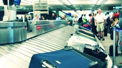 The airport in Denver Colorado baggage moves on the tape Stock Footage