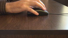 Closeup man right hand clicking computer mouse, scrolling and surfing internet - stock footage