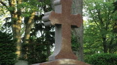 Cross on a tombstone Stock Footage