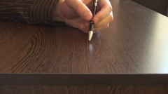 Anxiety at the office close up hand with pen knocking desk anxious irritated man Stock Footage