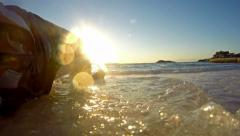 4k sitting on sand. refreshment at edge of beach sand and sea sunset. uhd sum Stock Footage