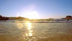4k marine sunset on the beach - tranquil idyllic scene of a golden sunset ove Stock Footage