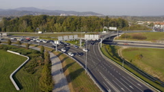 Aerial - Traffic waiting for a green light at roundabout Stock Footage