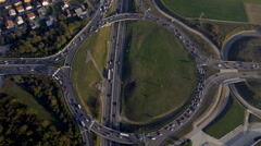 Aerial - City traffic at roundabout with traffic lights Stock Footage