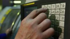 Metalworker Operates on Cnc Machine / Closeup Panel Stock Footage