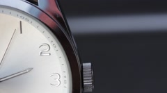 Close up shot of a clock and its seconds hand moving from top to bottom Stock Footage