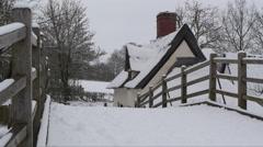 Bridge cottage in snow - stock footage