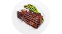 Fillet with asparagus served on white plate Stock Footage