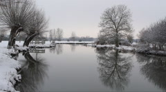 Snowy winter river scene Stock Footage
