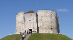 Tourists climbing steps to Clifford Tower Stock Footage