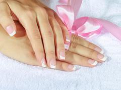 French manicure with pink and red hearts on the nails. Stock Photos