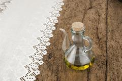glass jar of premium olive oil - stock photo