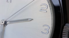 Close up shot of a white clock and its seconds hand Stock Footage
