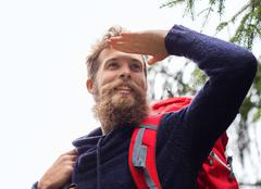 Smiling man with beard and backpack hiking Stock Photos
