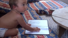 Baby with a menu card zoom in Stock Footage