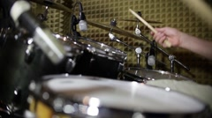 A man practicing drums in an isolated studio room Stock Footage
