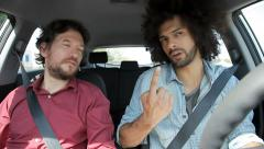 Friends talking in car while driving Stock Footage