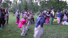Children competing jumping back and forth in linen bag Stock Footage