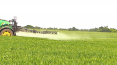 Agricultural machine spray field plants with chemical herbicide Stock Footage