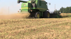 Agricultural machinery harvest ripe dry pea plants grow in field Stock Footage