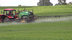 Stock Video Footage of Tractor spray field with chemical pesticide in summer