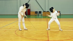 Little girl and trainer on a fencing training Stock Footage