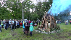 People enjoy huge fire place in Feast of St John. Panorama Stock Footage