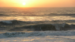 Sunrise along the Florida coast, surfers Stock Footage