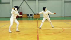 Two women on a fencing training Stock Footage