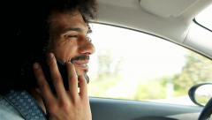 Happy handsome man driving car talking with cell phone Arkistovideo