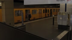 Yellow train on tube station in Berlin - stock footage