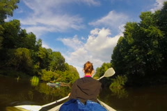 Active rest, young girl paddling boat on river, vacation, travel, click for HD - stock footage