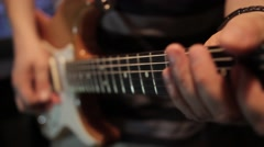 In a recording studio - a man playing on his electric guitar Stock Footage