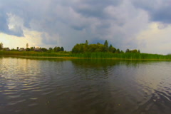 Wide river, countryside. Nature before storm, rapid motion, click for HD Stock Footage
