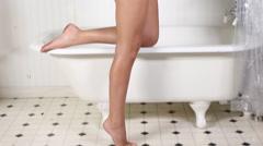 Pan up on beautiful bikini girl in bathroom Stock Footage