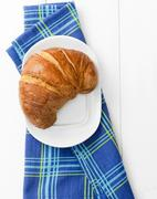 Stock Photo of croissant over bluish cloth