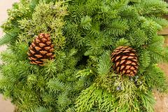 Stock Photo of evergreen wreath with pine cones and cedar