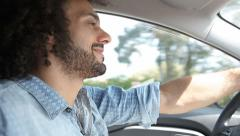 Smiling handsome man driving car happy Stock Footage