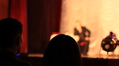 Spectators watching performance in the theater Stock Footage