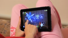 Girl playing video game on the tablet computer Stock Footage