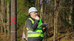 Thoughtful forest engineer to get idea in the forest Stock Footage